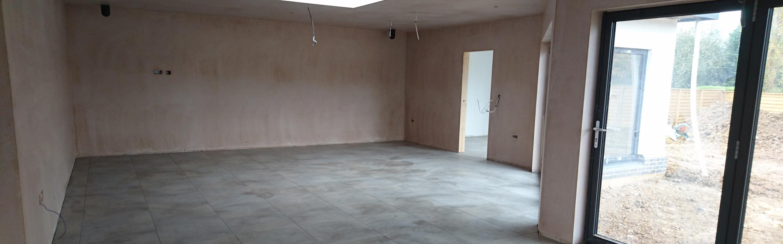 A board-skimmed room in a new build house.