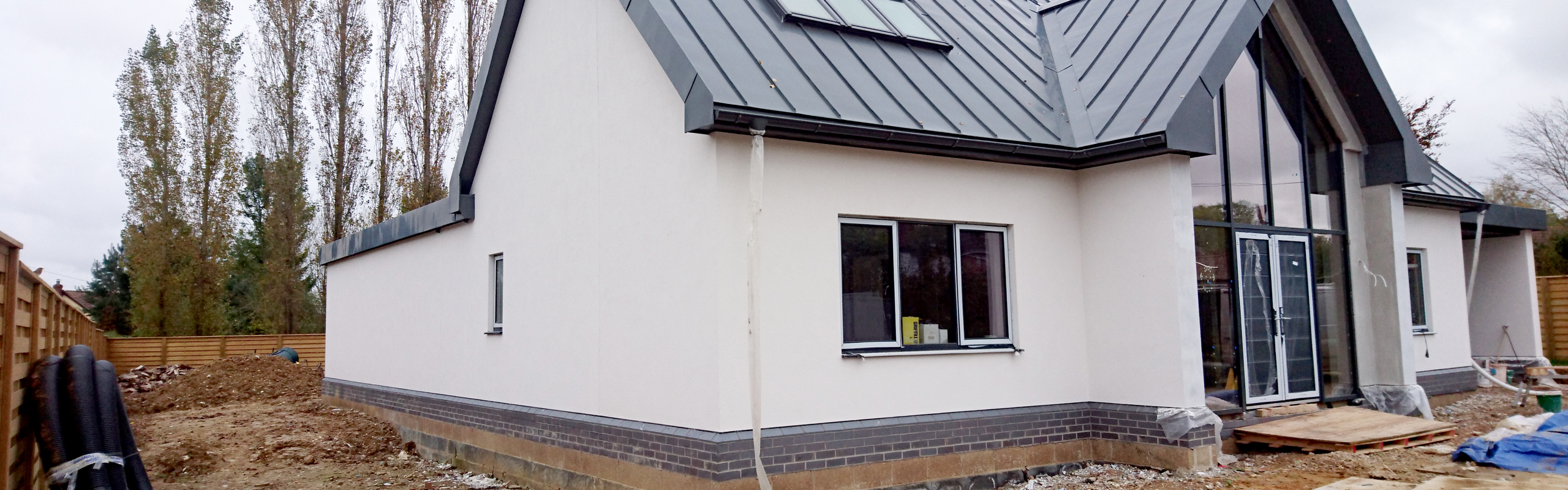 A newly built house with fresh external render.