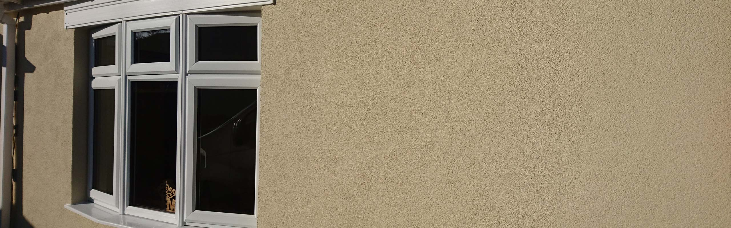 A house with EWI rendering.